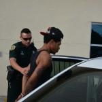 Police officer apprehending Darious Petress