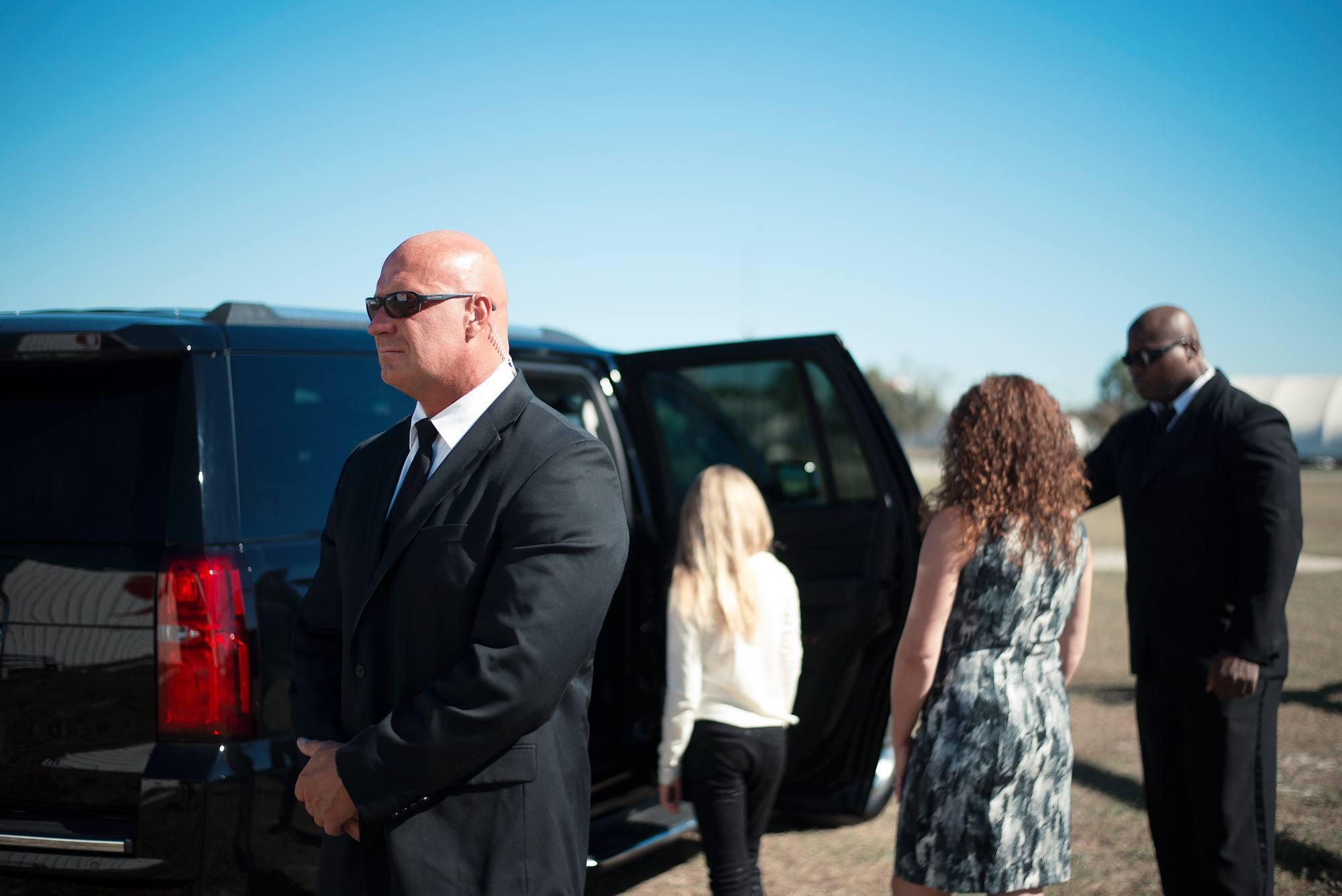 bodyguards-escorting-family